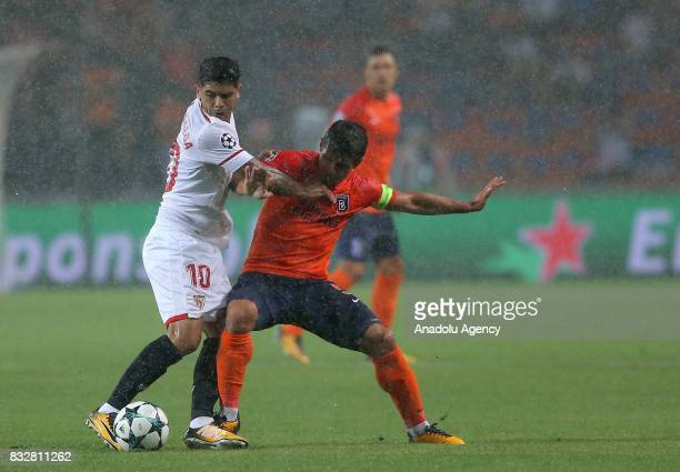 Emre Belözolu of Medipol Basaksehir in action against Ever Banega of Sevilla FC during the UEFA Champions League playoff match between Medipol...
