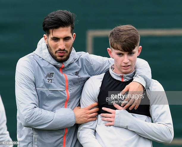 Emre Can and Ben Woodburn of Liverpool during a training session at Melwood Training Ground on April 21 2017 in Liverpool England