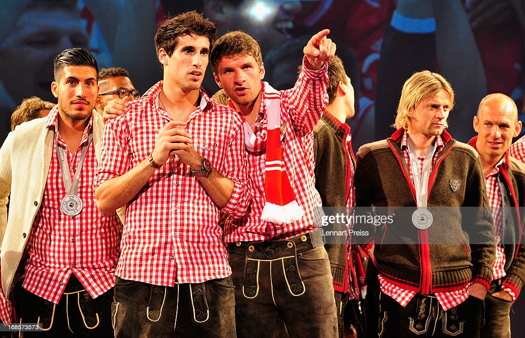 Emre Can, Javier Martinez, Thomas Mueller, Anatoliy Tymoshchuk and Arjen Robben of Bayern Muenchen celebrate winning the German Championship during the Official Champion dinner after winning the German championship at Postpalast on May 12, 2013 in Munich, Germany.