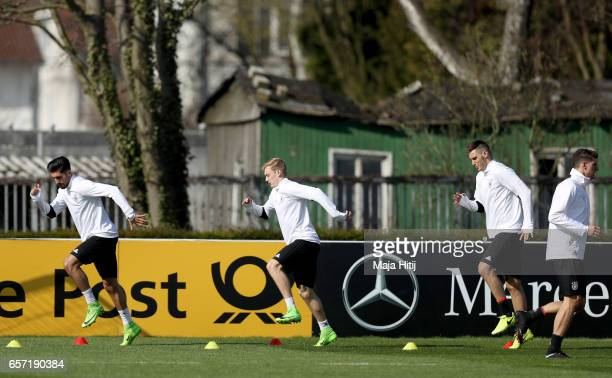 Emre Can Julian Brandt and Niklas Suele arm up during a Germany training session on March 24 2017 in Kamen Germany