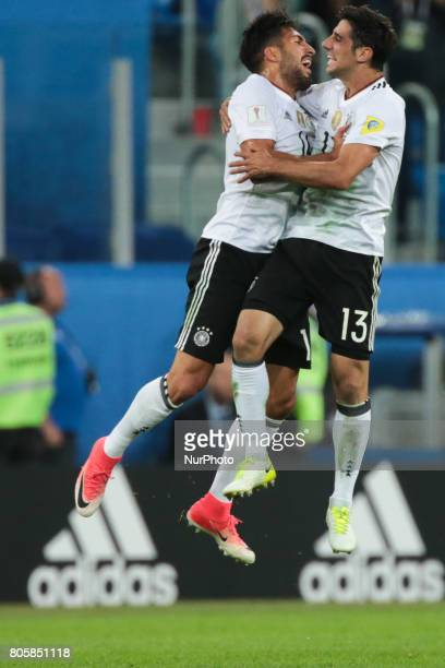Emre Can Lars Stindl of the Germany national football team celebrate winning after the 2017 FIFA Confederations Cup final match between Chile and...