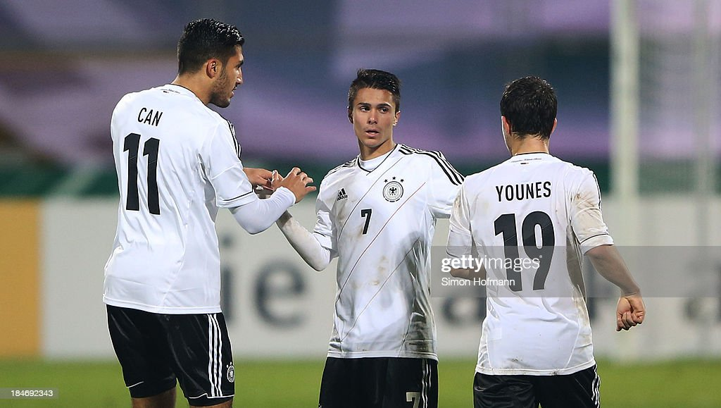 <a gi-track='captionPersonalityLinkClicked' href=/galleries/search?phrase=Emre+Can&family=editorial&specificpeople=5909273 ng-click='$event.stopPropagation()'>Emre Can</a>, <a gi-track='captionPersonalityLinkClicked' href=/galleries/search?phrase=Leonardo+Bittencourt&family=editorial&specificpeople=6735512 ng-click='$event.stopPropagation()'>Leonardo Bittencourt</a> and Amin Younes (L-R) celebrate their team's second goal during the 2015 UEFA European U21 Championships Qualifying Group Six match between Germany U21 and Faroe Islands U21 at Auestadion on October 15, 2013 in Kassel, Germany.