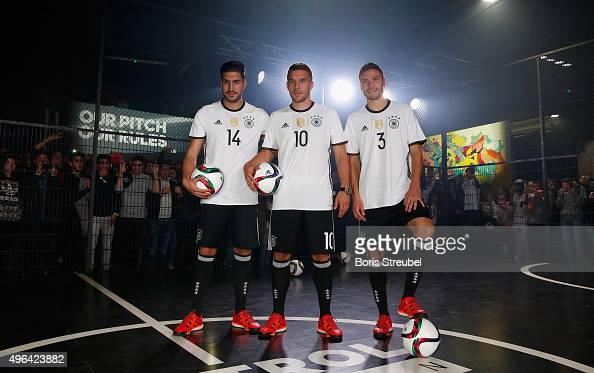 Emre Can Lukas Podolski and Jonas Hector attend the adidas presentation of new DFB home jersey for UEFA EURO 2016 at The Base on November 9 2015 in...