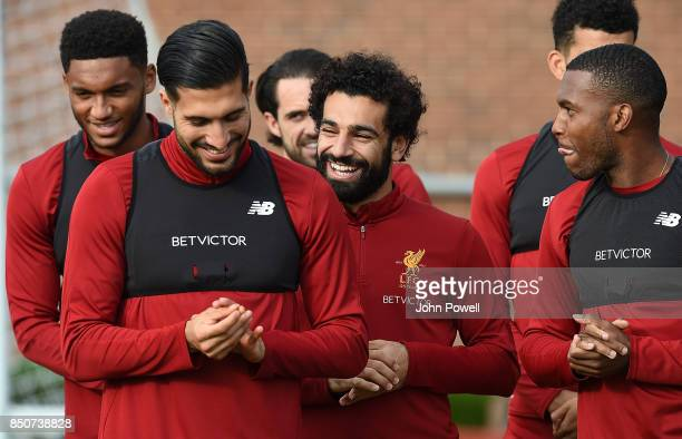 Emre Can Mohamed Salah and Daniel Sturridge of Liverpool during a training session at Melwood Training Ground on September 21 2017 in Liverpool...