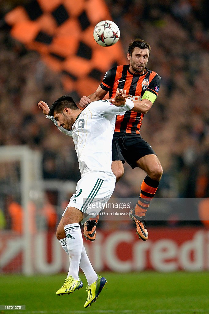 <a gi-track='captionPersonalityLinkClicked' href=/galleries/search?phrase=Emre+Can&family=editorial&specificpeople=5909273 ng-click='$event.stopPropagation()'>Emre Can</a> of Bayer Leverkusen is challenged by <a gi-track='captionPersonalityLinkClicked' href=/galleries/search?phrase=Darijo+Srna&family=editorial&specificpeople=546578 ng-click='$event.stopPropagation()'>Darijo Srna</a> of Shakhtar Donetsk during the UEFA Champions League Group A match between Shakhtar Donetsk and Bayer Leverkusen at Donbass Arena on November 5, 2013 in Donetsk, Ukraine.