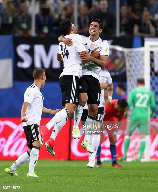 Emre Can of Germany and Lars Stindl of Germany celebrate victory after the FIFA Confederations Cup Russia 2017 Final between Chile and Germany at...