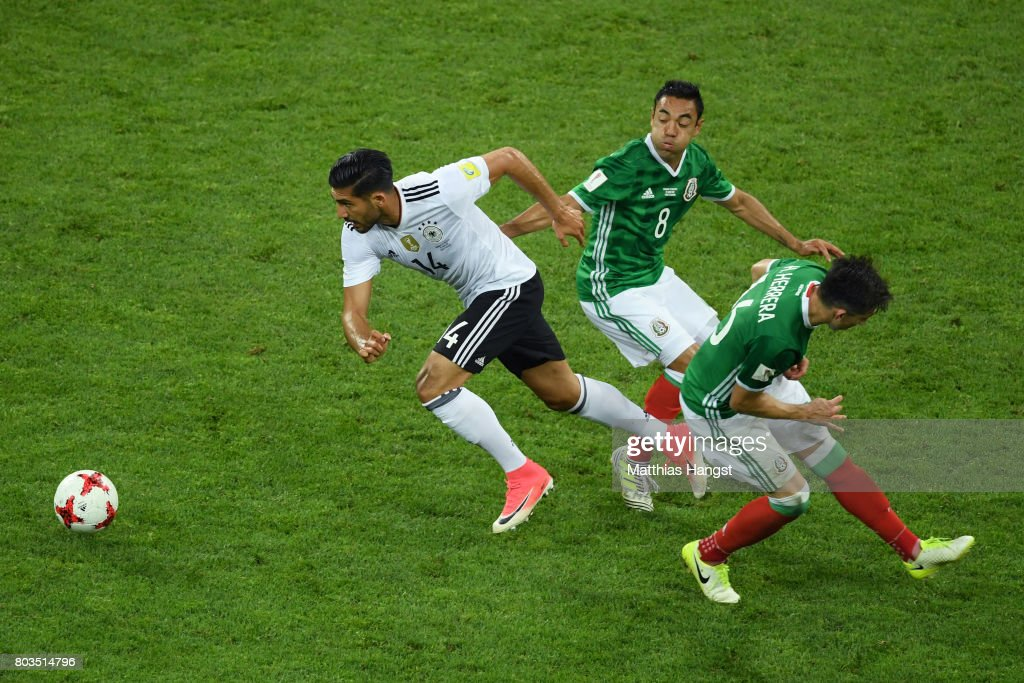 Emre Can of Germany goes past Marco Fabian and Hector Herrera of Mexico during the FIFA Confederations Cup Russia 2017 Semi-Final between Germany and Mexico at Fisht Olympic Stadium on June 29, 2017 in Sochi, Russia.