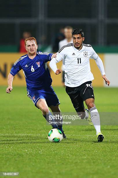 Emre Can of Germany is challenged by Trondur Jensen of Faroe Islands during the 2015 UEFA European U21 Championships Qualifying Group Six match...