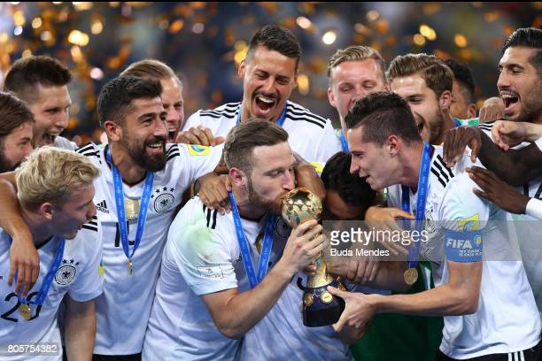Emre Can of Germany kisses the trophy after the FIFA Confederations Cup Russia 2017 Final between Chile and Germany at Saint Petersburg Stadium on...