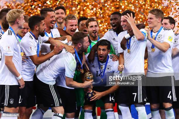 Emre Can of Germany lifts the trophy following the FIFA Confederations Cup Russia 2017 Final match between Chile and Germany at Saint Petersburg...