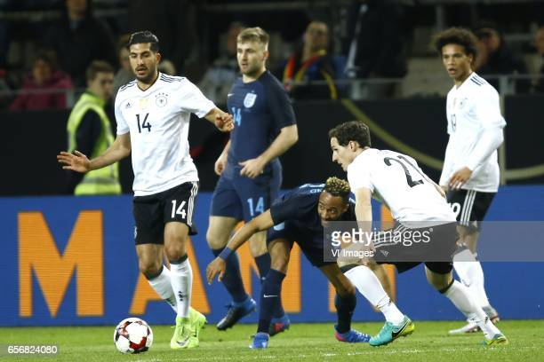 Emre Can of Germany Nathan Redmond of England Sebastian Rudy of Germany Leroy Sane of Germanyduring the friendly match between Germany and England on...