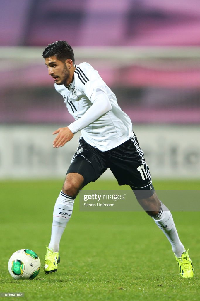 <a gi-track='captionPersonalityLinkClicked' href=/galleries/search?phrase=Emre+Can&family=editorial&specificpeople=5909273 ng-click='$event.stopPropagation()'>Emre Can</a> of Germany runs with the ball during the 2015 UEFA European U21 Championships Qualifying Group Six match between Germany U21 and Faroe Islands U21 at Auestadion on October 15, 2013 in Kassel, Germany.
