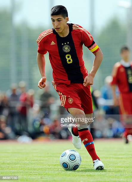Emre Can of Germany runs with the ball during the U15 match between Germany and Poland at the Sportzentrum Niedergruendauer Street Stadium on June 10...