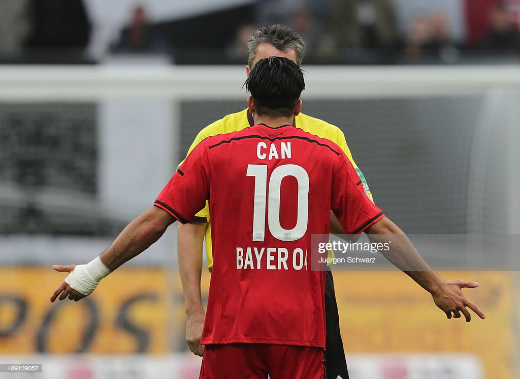 <a gi-track='captionPersonalityLinkClicked' href=/galleries/search?phrase=Emre+Can&family=editorial&specificpeople=5909273 ng-click='$event.stopPropagation()'>Emre Can</a> of Leverkusen gestures in front of referee <a gi-track='captionPersonalityLinkClicked' href=/galleries/search?phrase=Knut+Kircher&family=editorial&specificpeople=645627 ng-click='$event.stopPropagation()'>Knut Kircher</a> during the Bundesliga match between Bayer 04 Leverkusen and Werder Bremen at BayArena on May 10, 2014 in Leverkusen, Germany.