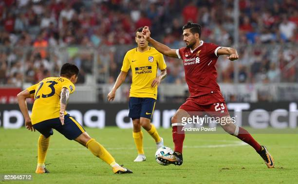Emre Can of Liveprool competes with Matias Kranevitter of Atletico Madrid during the Audi Cup 2017 match between Liverpool FC and Atletico Madrid at...