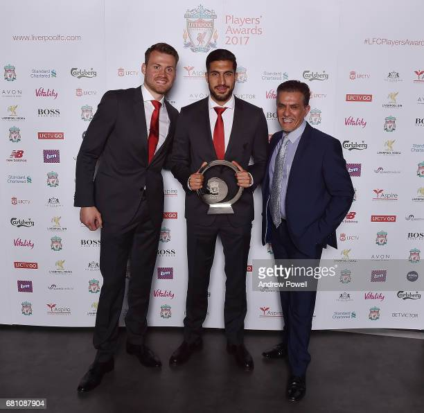 Emre Can of Liverpool after winning the Goal of the Season award with Simon Mignolet and Rajnish Luthra during the Liverpool FC Player Awards at...