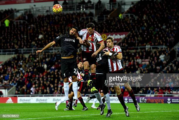 Emre Can of Liverpool and Billy Jones of Sunderland jump for the ball in front of Mamadou Sakho of Liverpool and Sebastian Coates of Sunderland...