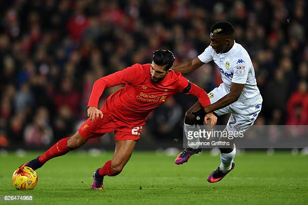Emre Can of Liverpool and Hadi Sacko of Leeds United battle for the ball during the EFL Cup QuarterFinal match between Liverpool and Leeds United at...