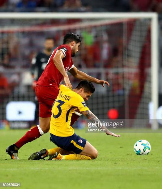 Emre Can of Liverpool and Kranevitter of Atletico Madrid battle for the ball during the Audi Cup 2017 match between Liverpool FC and Atletico Madrid...