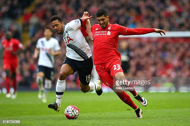 Emre Can of Liverpool and Mousa Dembele of Tottenham Hotspur compete for the ball during the Barclays Premier League match between Liverpool and...