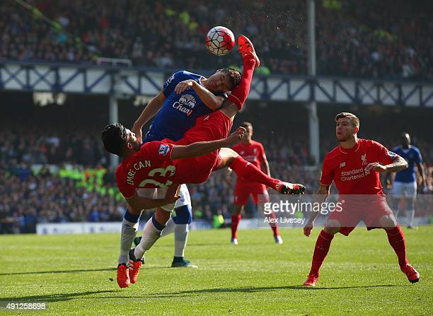 Emre Can of Liverpool and Ramiro Funes Mori of Everton in action during the Barclays Premier League match between Everton and Liverpool at Goodison...