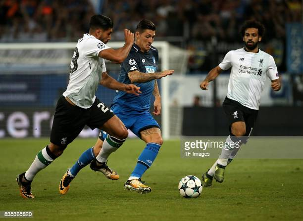 Emre Can of Liverpool and Steven Zuber of Hoffenheim and Mohamed Salah of Liverpool battle for the ball during the UEFA Champions League Qualifying...