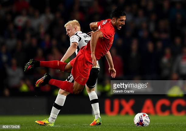 Emre Can of Liverpool and Will Hughes of Derby County in action during the EFL Cup Third Round match between Derby County and Liverpool at iPro...