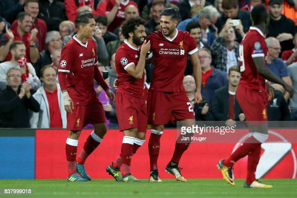 Emre Can of Liverpool celebrates scoring his sides third goal with Mohamed Salah of Liverpool and Roberto Firmino of Liverpool during the UEFA...