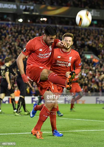 Emre Can of Liverpool celebrates with teammate Adam Lallana of Liverpool after scoring a goal to level the scores at 11 during the UEFA Europa League...