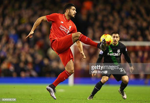 Emre Can of Liverpool clears the ball from Bojan Krkic of Stoke City during the Capital One Cup semi final second leg match between Liverpool and...