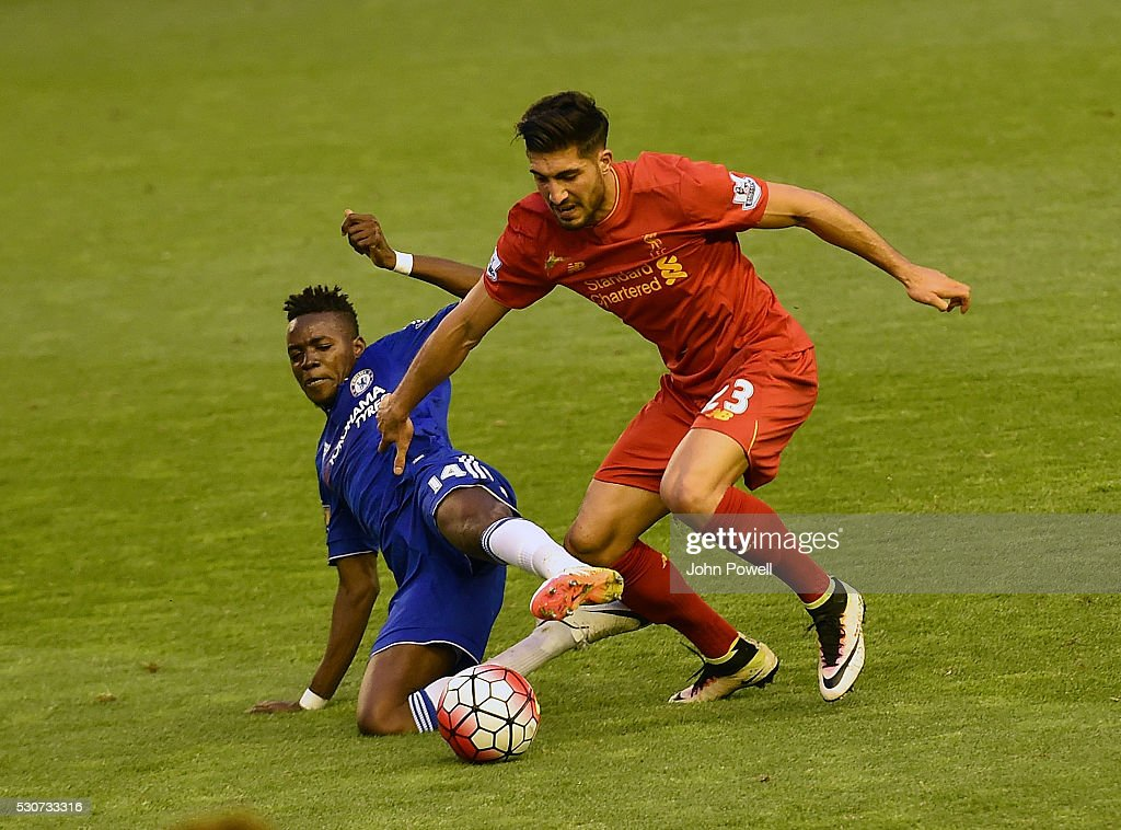Emre Can of Liverpool competes with Baba Rahman of Chelsea during the Barclays Premier League match between Liverpool and Chelsea at Anfield on May 11, 2016 in Liverpool, England.