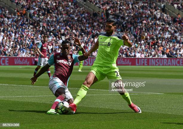 Emre Can of Liverpool competes with Edimilson Fernandes of West Ham United during the Premier League match between West Ham United and Liverpool at...