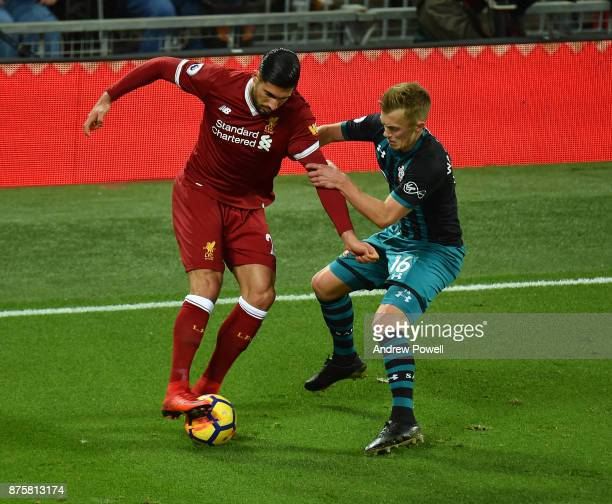 Emre Can of Liverpool competes with James WardProwse of Southampton during the Premier League match between Liverpool and Southampton at Anfield on...