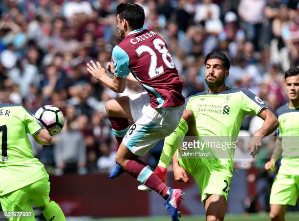 Emre Can of Liverpool competes with Jonathan Calleri of West Ham United during the Premier League match between West Ham United and Liverpool at...