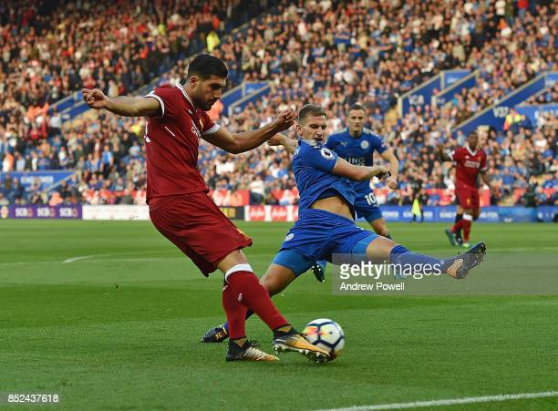 Emre Can of Liverpool competes with Marc Albrighton of Leicester City during the Premier League match between Leicester City and Liverpool at The...