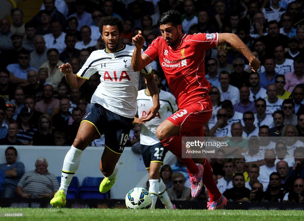 Emre Can of Liverpool competes with Mousa Dembele of Tottenham Hotspur during the Barclays Premier League match between Tottenham Hotspur and Liverpool at White Hart Lane on August 31, 2014 in London, England.