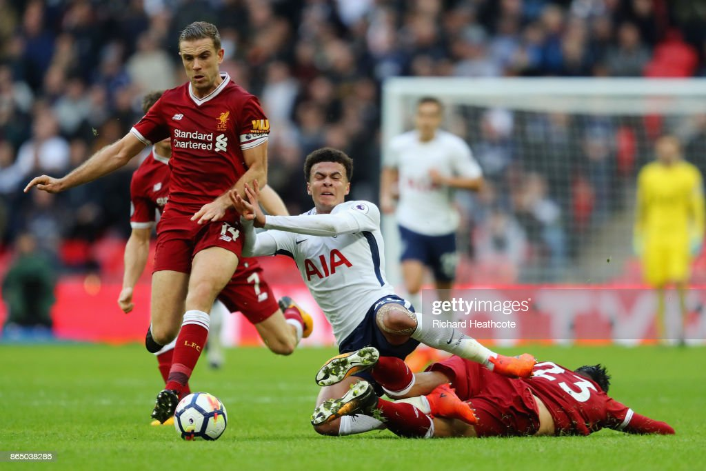 Emre Can of Liverpool fouls Dele Alli of Tottenham Hotspur during the Premier League match between Tottenham Hotspur and Liverpool at Wembley Stadium on October 22, 2017 in London, England.