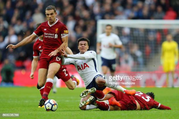 Emre Can of Liverpool fouls Dele Alli of Tottenham Hotspur during the Premier League match between Tottenham Hotspur and Liverpool at Wembley Stadium...