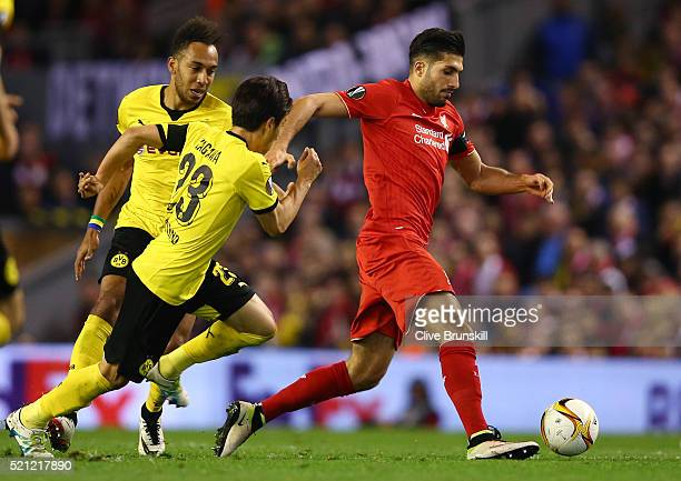 Emre Can of Liverpool goes past PierreEmerick Aubameyang of Borussia Dortmund during the UEFA Europa League quarter final second leg match between...