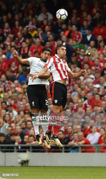 Emre Can of Liverpool goes up with Sabin Merino of Athletic Bilbao during a pre season friendly match between Liverpool and Athletic Bilbao at Aviva...