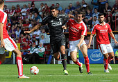Emre Can of Liverpool in action with Michael Williams of Swindon Town during a preseason friendly at County Ground on August 2 2015 in Swindon England