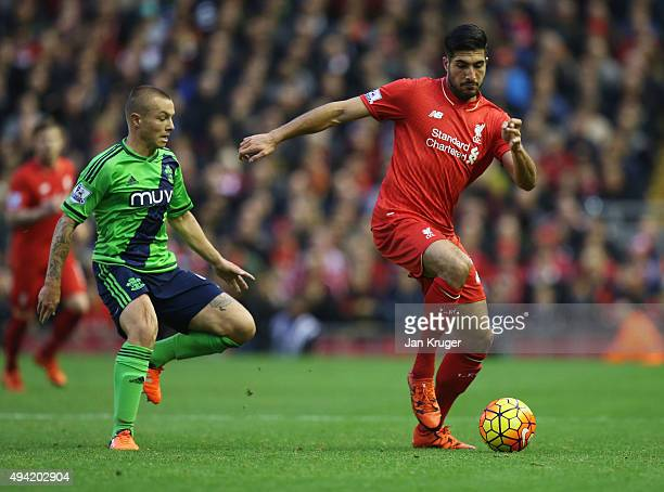 Emre Can of Liverpool is challenged by Jordy Clasie of Southampton during the Barclays Premier League match between Liverpool and Southampton at...