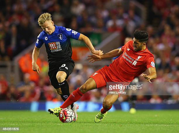 Emre Can of Liverpool is challenged by Matt Ritchie of Bournemouth during the Barclays Premier League match between Liverpool and AFC Bournemouth at...
