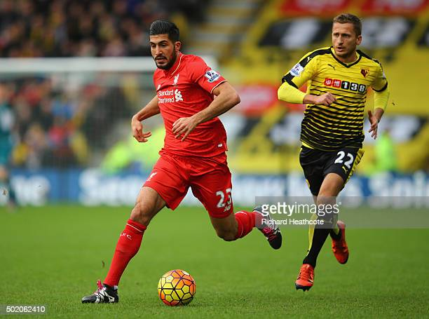 Emre Can of Liverpool is chased by Almen Abdi of Watford during the Barclays Premier League match between Watford and Liverpool at Vicarage Road on...