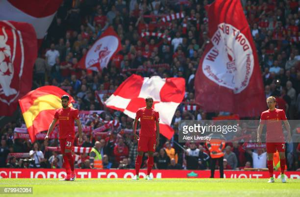 Emre Can of Liverpool Joel Matip of Liverpool and Lucas Leiva of Liverpool look on prior to the Premier League match between Liverpool and...