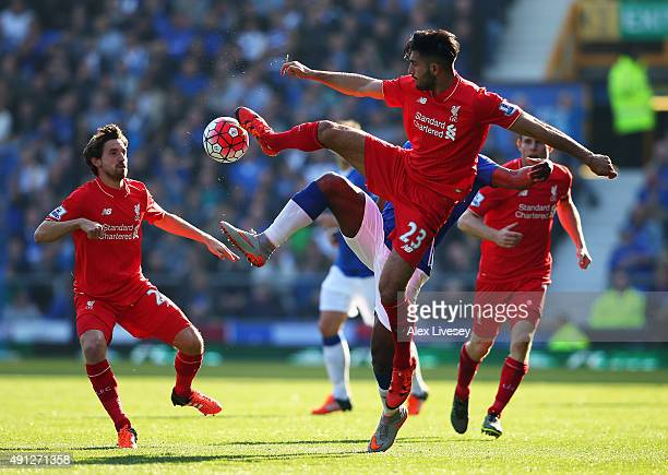 Emre Can of Liverpool jumps for the high ball during the Barclays Premier League match between Everton and Liverpool at Goodison Park on October 4...