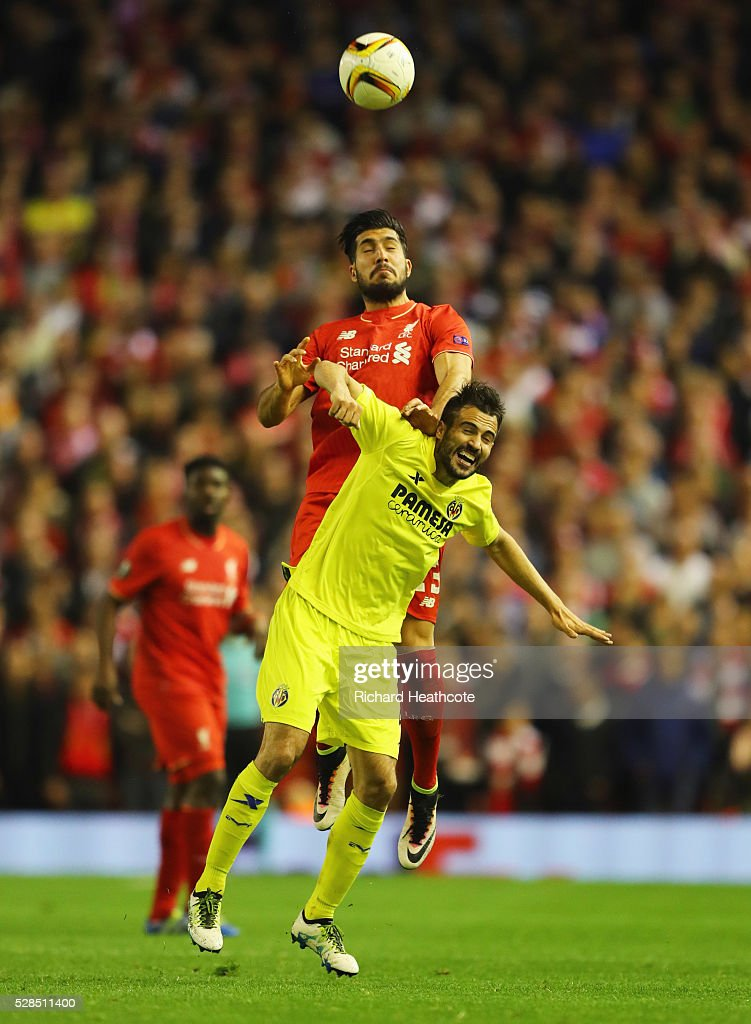 Emre Can of Liverpool outjumps Mario Gaspar of Villarreal during the UEFA Europa League semi final second leg match between Liverpool and Villarreal CF at Anfield on May 5, 2016 in Liverpool, England.