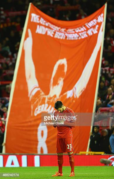 Emre Can of Liverpool prayers ahead of the Barclays Premier League match between Liverpool and Burnley at Anfield on March 4 2015 in Liverpool England