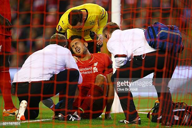 Emre Can of Liverpool receives treatment during the UEFA Europa League quarter final second leg match between Liverpool and Borussia Dortmund at...