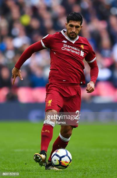 Emre Can of Liverpool runs with the ball during the Premier League match between Tottenham Hotspur and Liverpool at Wembley Stadium on October 22...